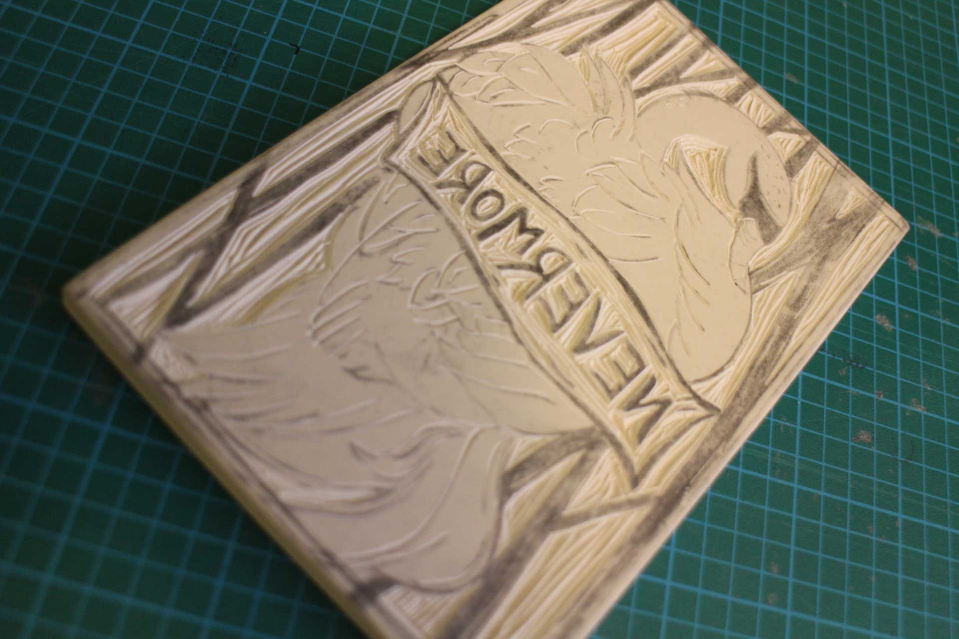Nevermore linocut carving process