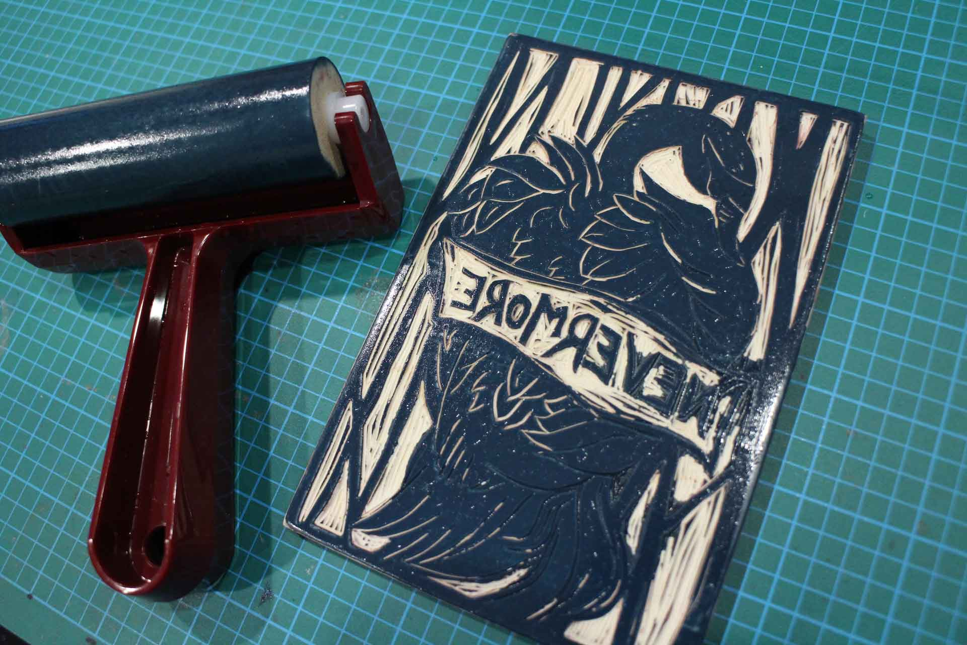 Nevermore linocut inking process